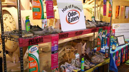 Dirty sneakers on racks with Odor-Eaters products