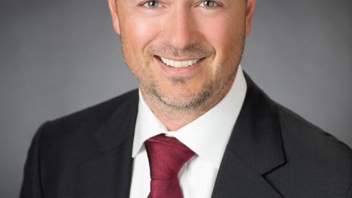 Matt Davey, Group Chief Executive of SG Digital, smiling in a headshot photo
