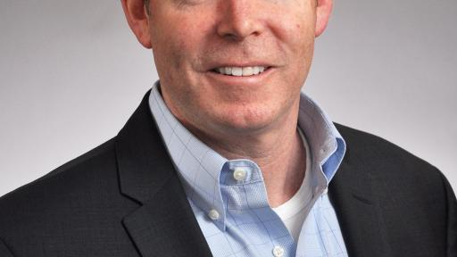 Pat McHugh, SVP Global Lottery Systems, smiling in a headshot photo