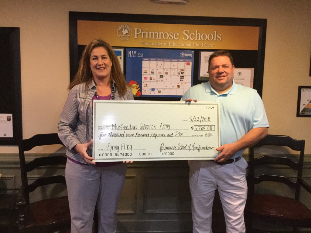 Primrose Franchise Owner Susan Burrow presents a check to the local Salvation Army in Murfreesboro, Tenn., in celebration of a great fundraising campaign by Primrose School of Murfreesboro.