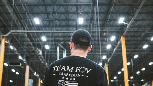 Brian Steorts standing in a factory with back to the screen, sporting a Team FOV Craftsman shirt.