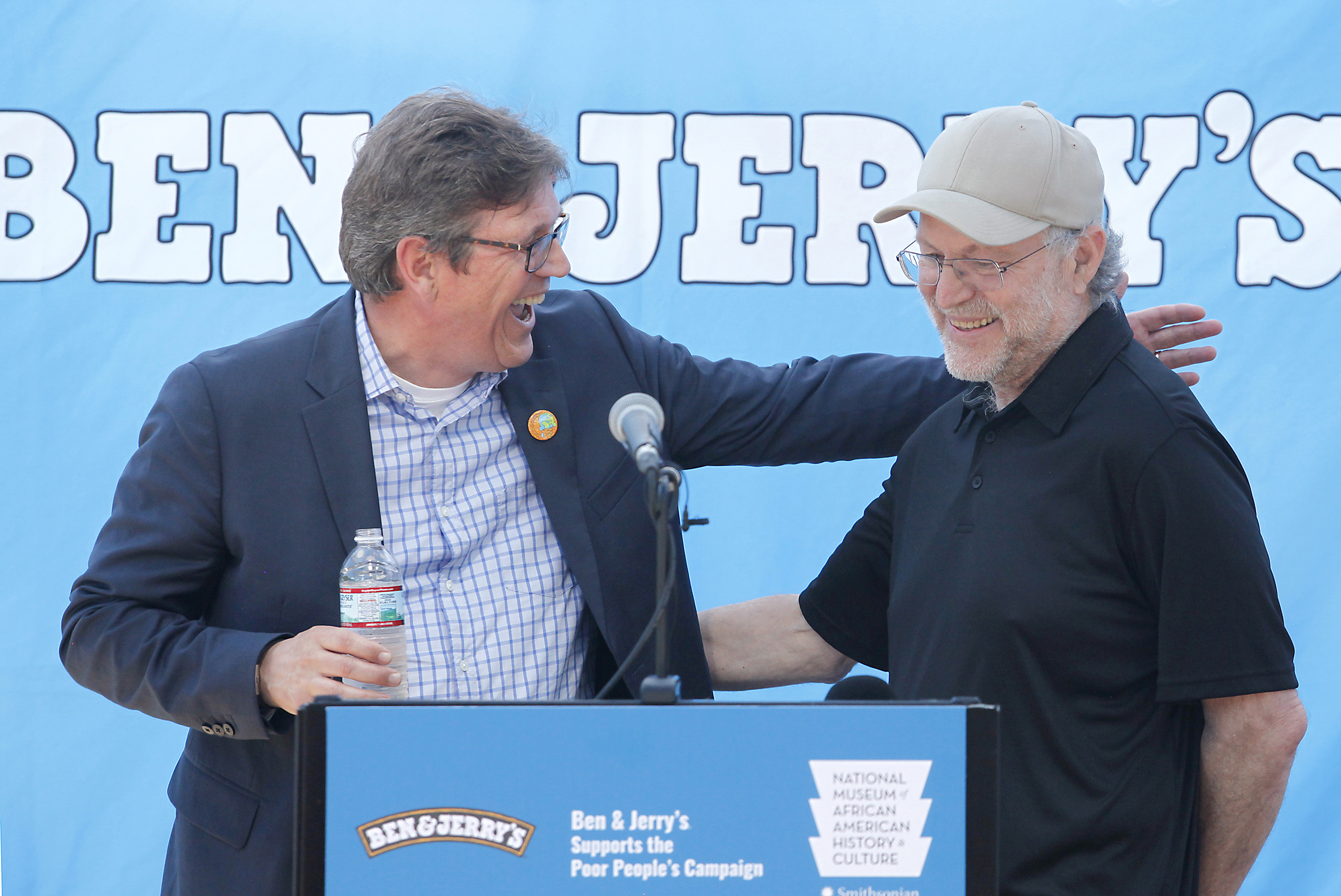 Ben & Jerry's CEO Jostein Solheim welcomes Co-Founder Jerry Greenfield at the opening of an exhibit on the 1968 Poor People's Campaign at the company's Vermont ice cream factory.