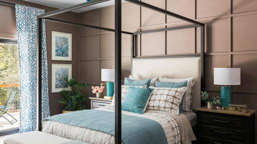 A master bedroom, complete with queen-sized bed, a nightstand on either side, and other fixtures. A patio is connected to the room.