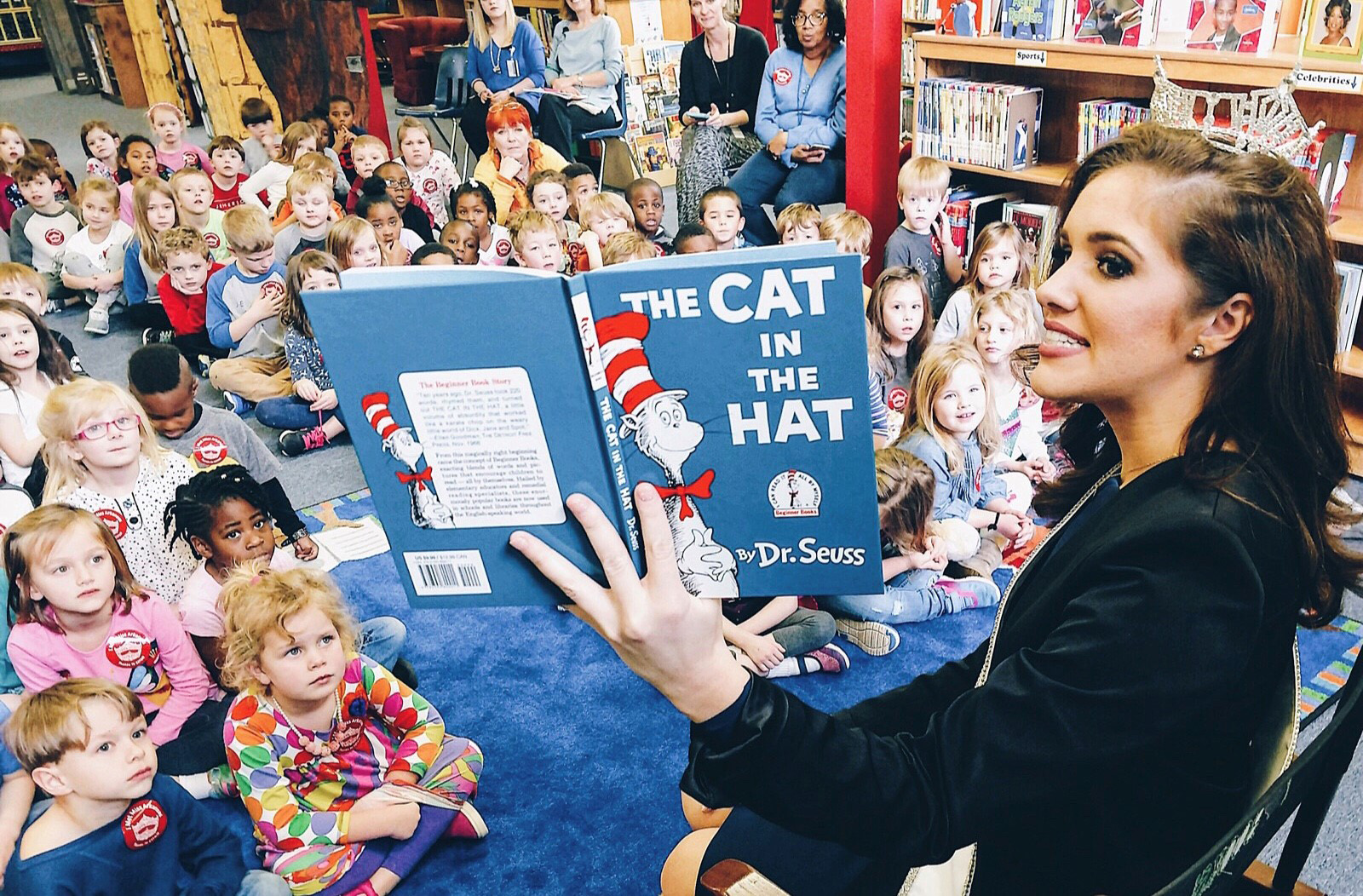 "Miss Arkansas 2017, Maggie Benton, is 'fueling' a love of reading with students during National Reading Month by reading her favorite book ""The Cat in the Hat."""