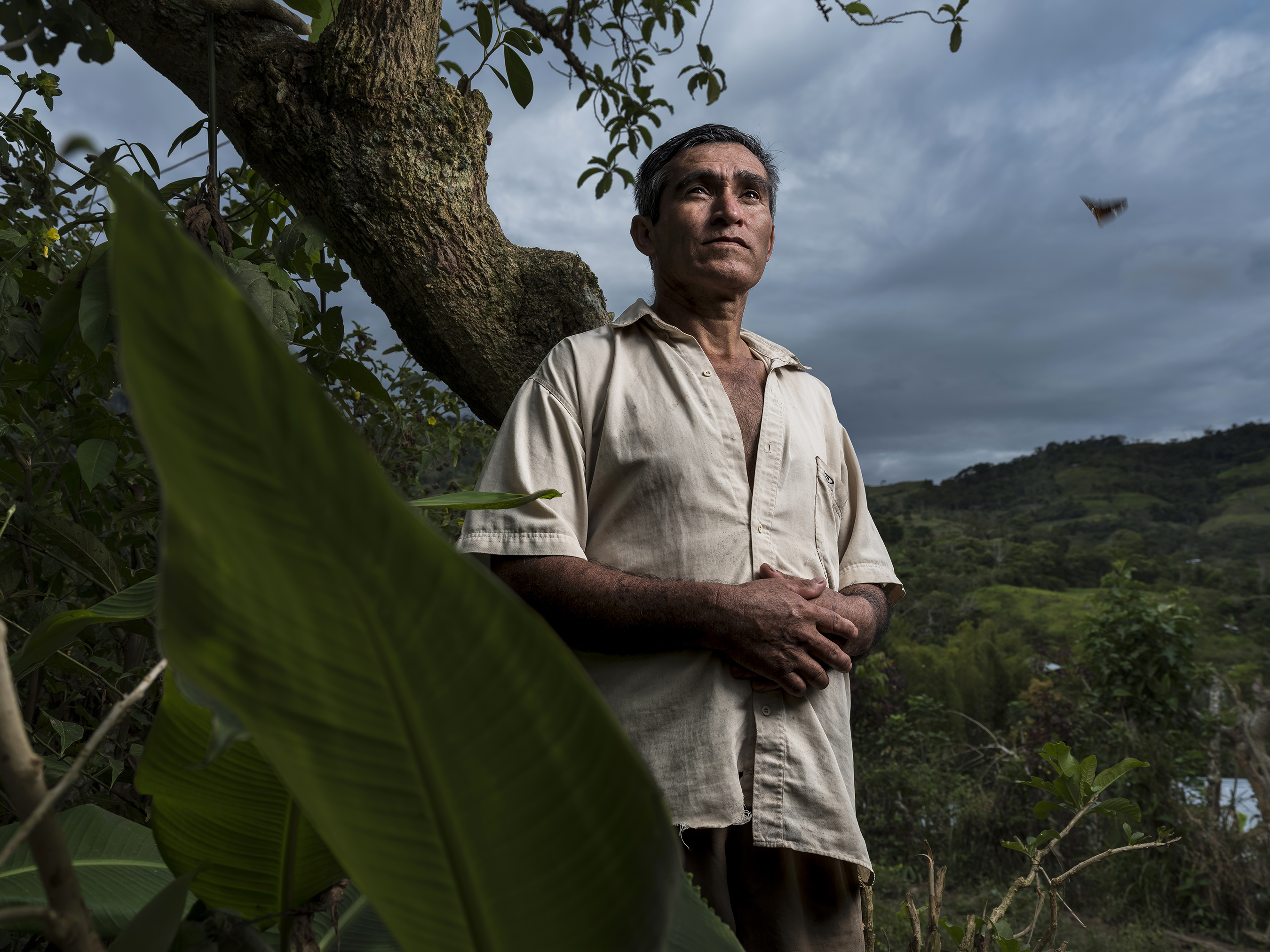 José out in the coffee field where he works
