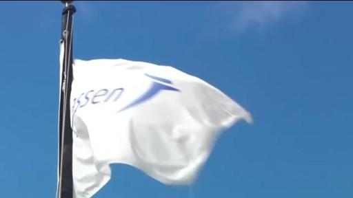 Janssen flag in the foreground with the blue sky in the background