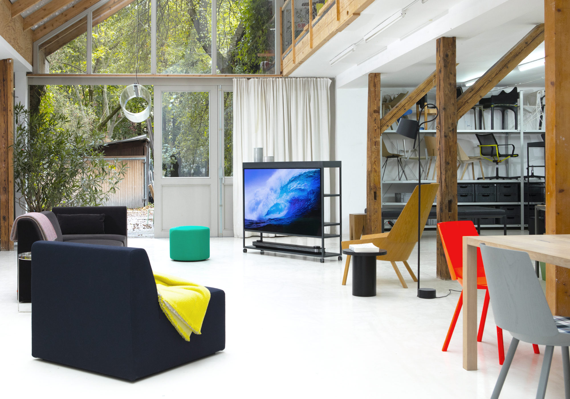 Lg signature universal appeal to interior designers and architects in the studio of designer stefan diez stands the lg signature oled tv w which biocorpaavc