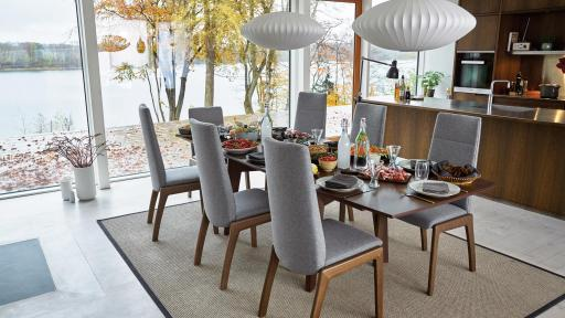 Walnut dining table and grey chairs