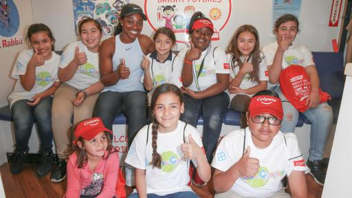 Kids give thumbs-up for Serving Up Smiles initiative.