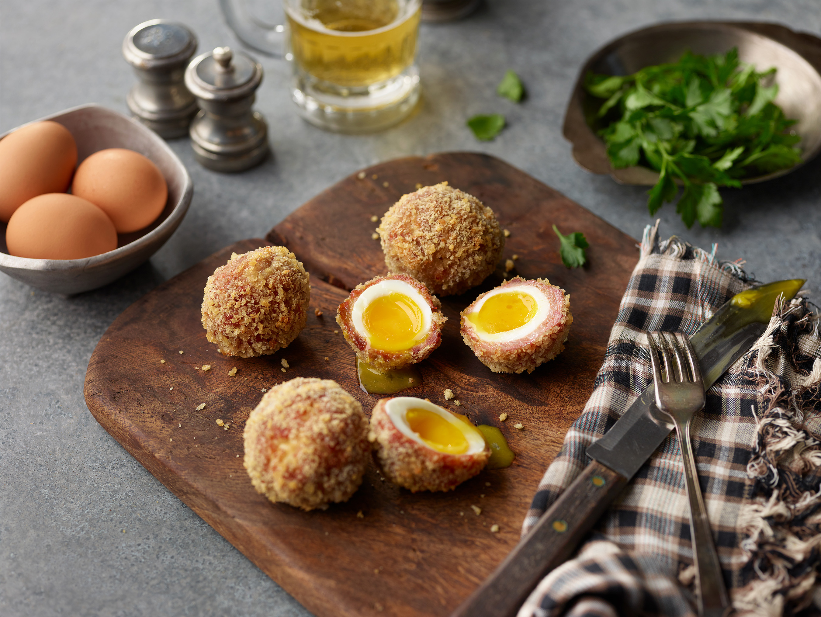 Bring a gastropub staple home by cooking up a hard-boiled egg wrapped in sausage and crispy cracker shell.