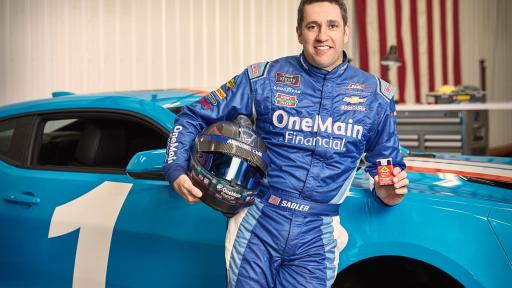 NASCAR Driver Elliott Sadler standing by his blue race car