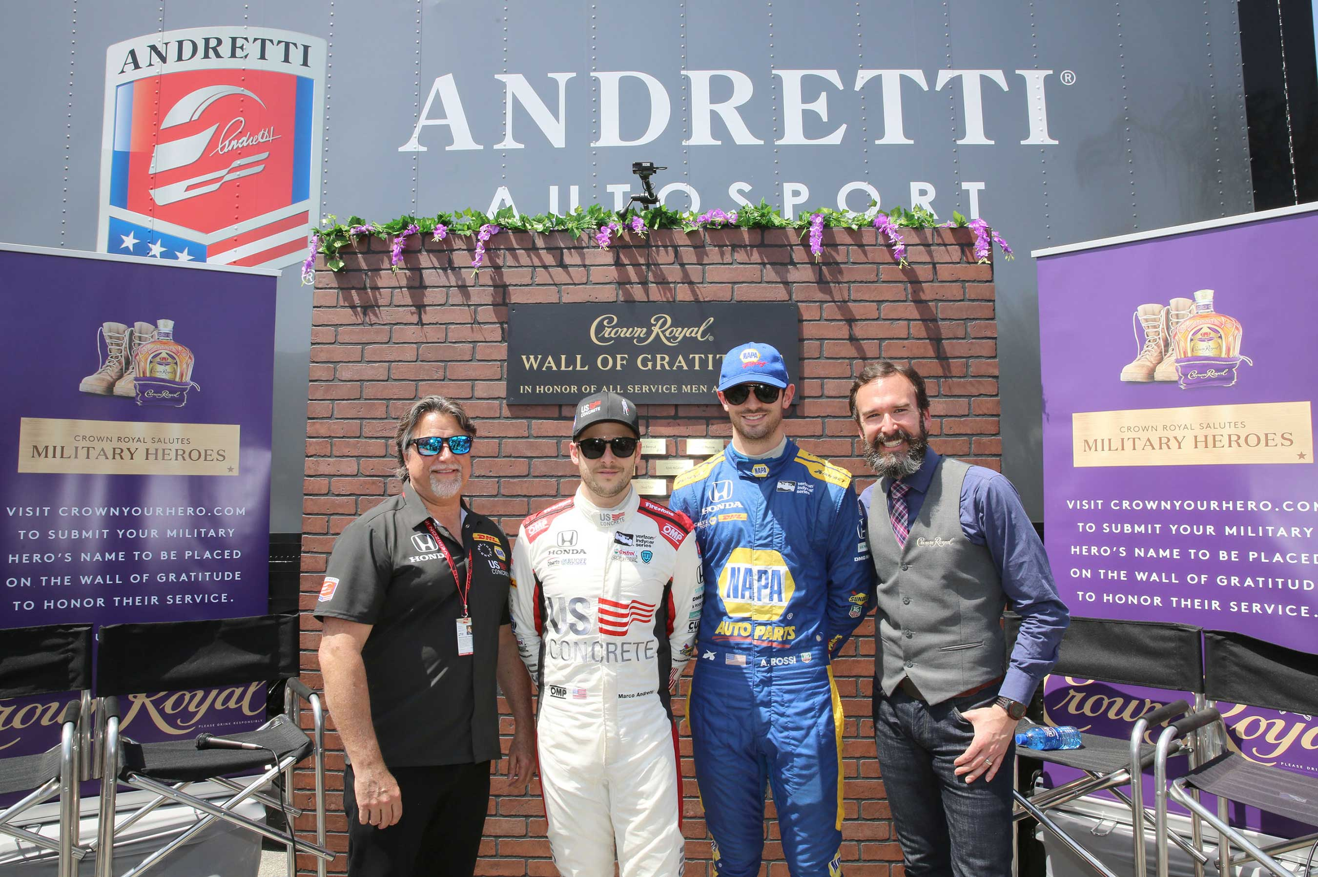 (L-R) Andretti Autosport CEO and Chairman Michael Andretti, Verizon IndyCar Series driver Marco Andretti, Verizon IndyCar Series driver Alexander Rossi, and Crown Royal Director of Whisky Engagement Stephen Wilson pictured during Crown Royal and Andretti Autosport team up to honor military heroes on April 13, 2018 in Long Beach, California. (Photo by Rachel Murray/Getty Images for Crown Royal)