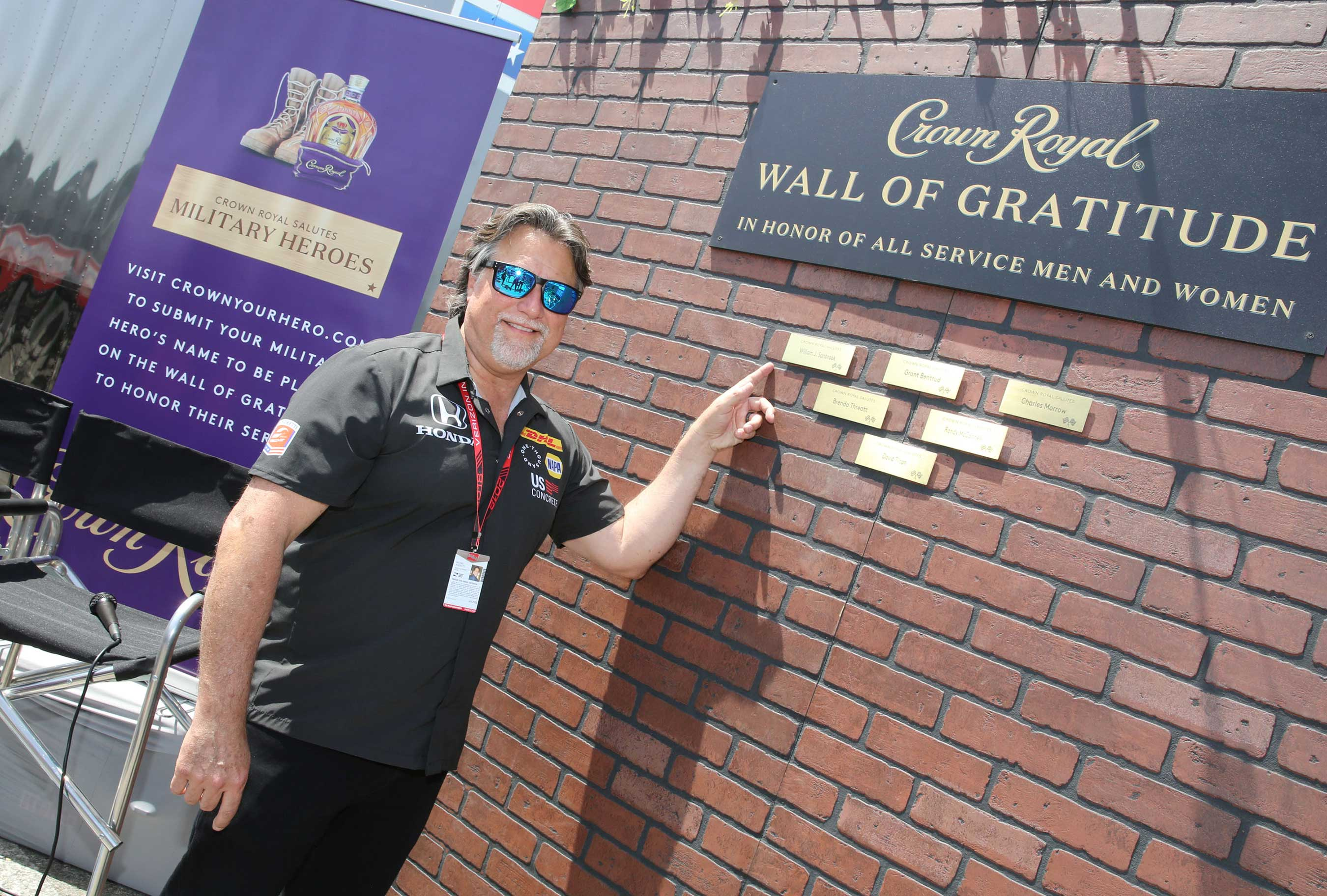 Andretti Autosport CEO and Chairman Michael Andretti pictured with the Wall of Gratitude during Crown Royal and Andretti Autosport team up to honor military heroes on April 13, 2018 in Long Beach, California. (Photo by Rachel Murray/Getty Images for Crown Royal)