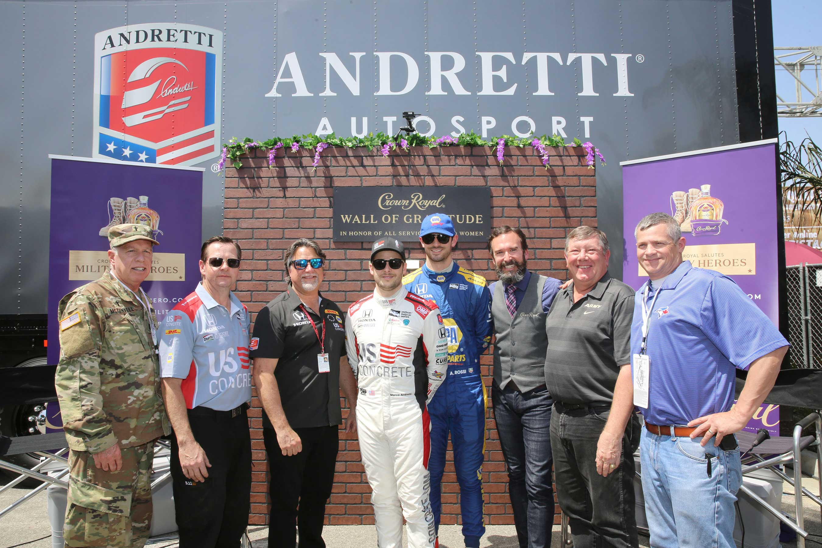 (L-R) Captain Randy Mc Connell, Grant Bentrud, Andretti Autosport CEO and Chairman Michael Andretti, Verizon IndyCar Series driver Marco Andretti, Verizon IndyCar Series driver Alexander Rossi, and Crown Royal Director of Whisky Engagement Stephen Wilson, William J Sandbrook, and Sergeant Dean Gness pictured during Crown Royal and Andretti Autosport team up to honor military heroes on April 13, 2018 in Long Beach, California. (Photo by Rachel Murray/Getty Images for Crown Royal)
