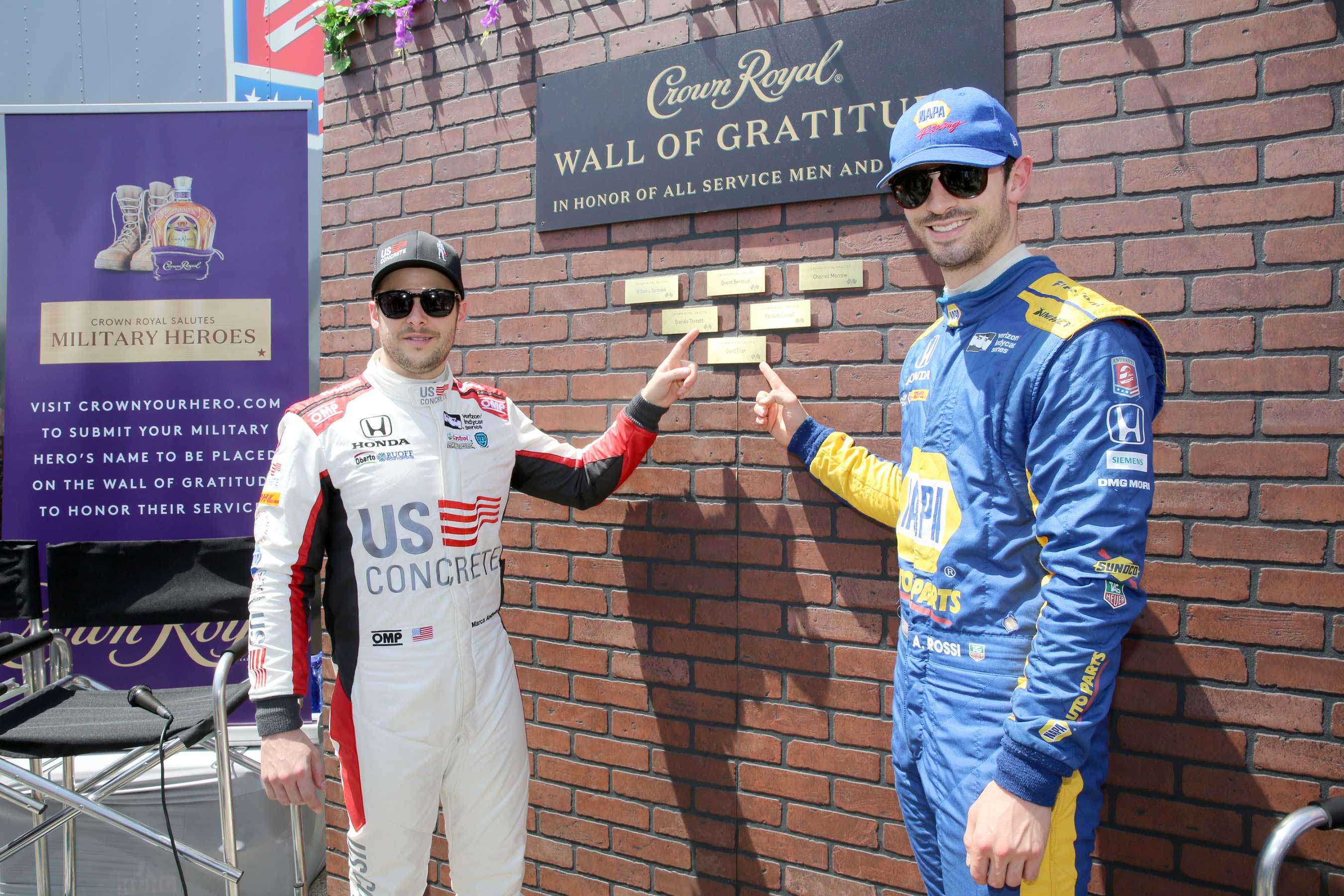 (L-R) Verizon IndyCar Series drivers Marco Andretti and Alexander Rossi pictured with the Wall of Gratitude during Crown Royal and Andretti Autosport team up to honor military heroes on April 13, 2018 in Long Beach, California. (Photo by Rachel Murray/Getty Images for Crown Royal)