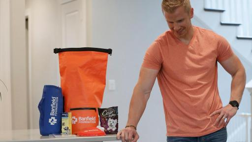 Sean Lowe and his dog Ellie with a Pet Disaster Preparedness Kit