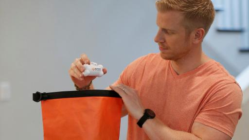 Sean Lowe Examining Ellie's Banfield Foundation Disaster Prepared Kit