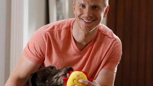 Sean Lowe Playing with his Dog