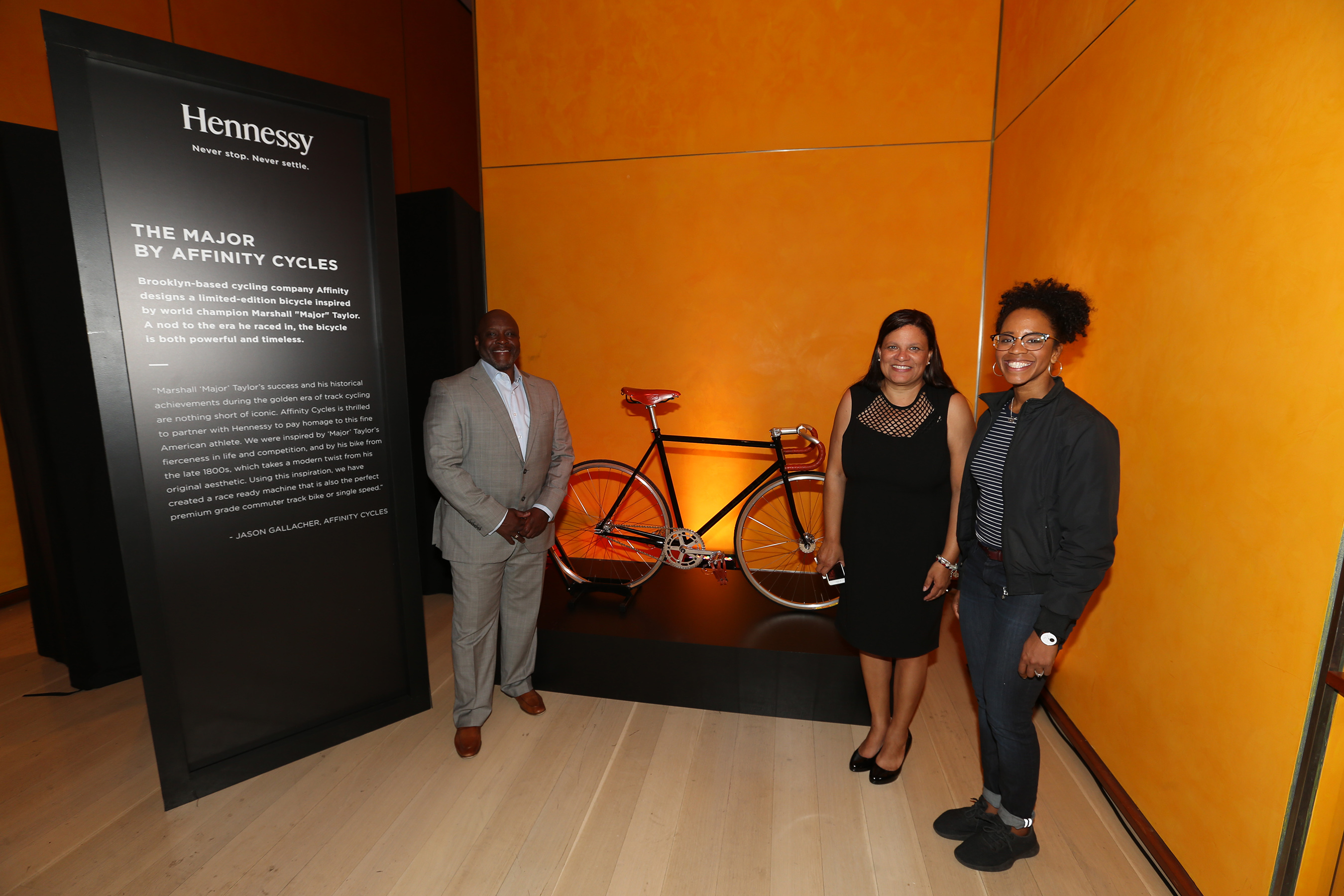 "Anthony Taylor of the National Brotherhood of Cyclists joins Marshall ""Major"" Taylor's great granddaughter, Karen Brown-Donovan, and American road cyclist Ayesha McGowan."