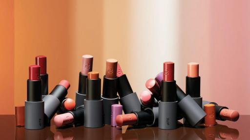 Lipsticks in various colors stood upright