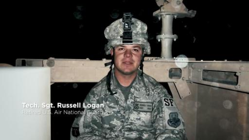 Picture of Tech Sergeant Russell Logan in fatigues at night.
