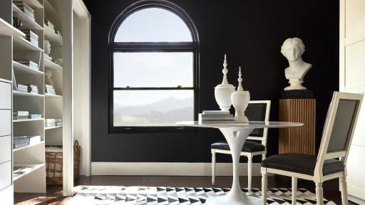 Casement window in a room with walls painted black