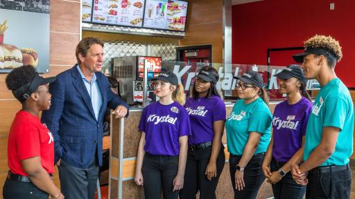 Michael Klump, Chairman of Krystal and CEO of Argonne Capital Group with Krystal employees