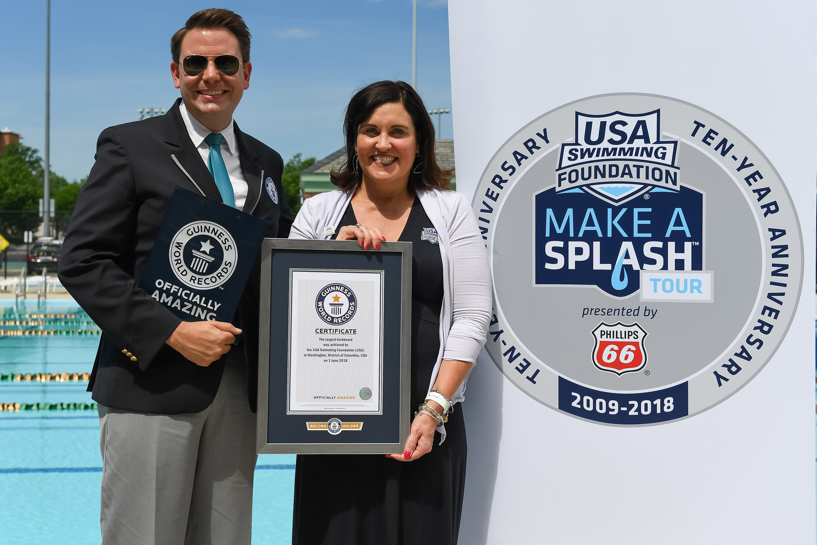 PHOTO CREDIT: © Mike Lewis / USA Swimming Foundation - USA Swimming Foundation Executive Director Debbie Hesse receives the official GUINNESS WORLD RECORDS© recognition from GWR adjudicator Michael Empric.