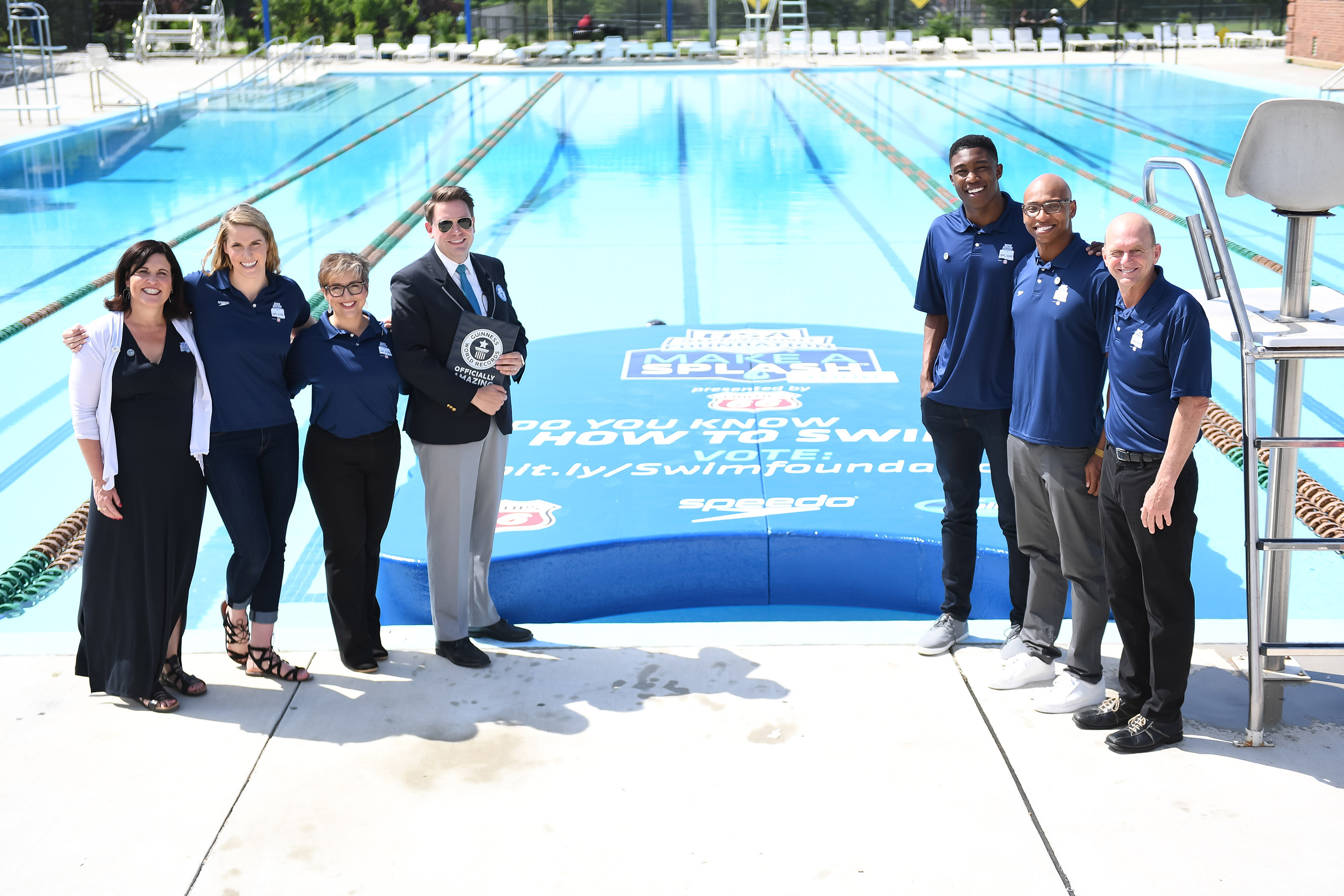 PHOTO CREDIT: © Mike Lewis / USA Swimming Foundation - USA Swimming Foundation Executive Director Debbie Hesse, USA Swimming Foundation ambassador Missy Franklin, Phillips 66 Manager Tami Talbert Walker, adjudicator Michael Empric, World Junior Champion swimmer Reece Whitley, Olympians Cullen Jones and Rowdy Gaines flank the GUINNESS WORLD RECORDS® Largest Kickboard during the USA Swimming Foundation's Make a Splash tour presented by Phillips 66.