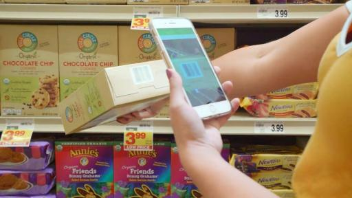 Person using the SmartLabel Food Product to scan a label