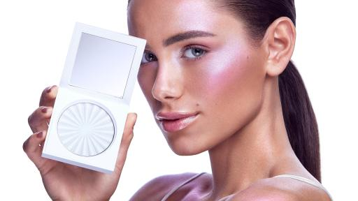 Model holding the Space Baby highlighter product.