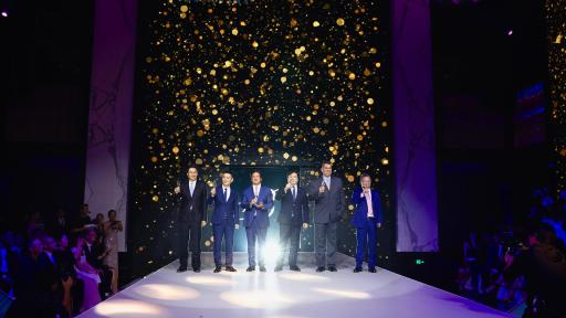 The management of Suning standing on a stage at the Bellagio.