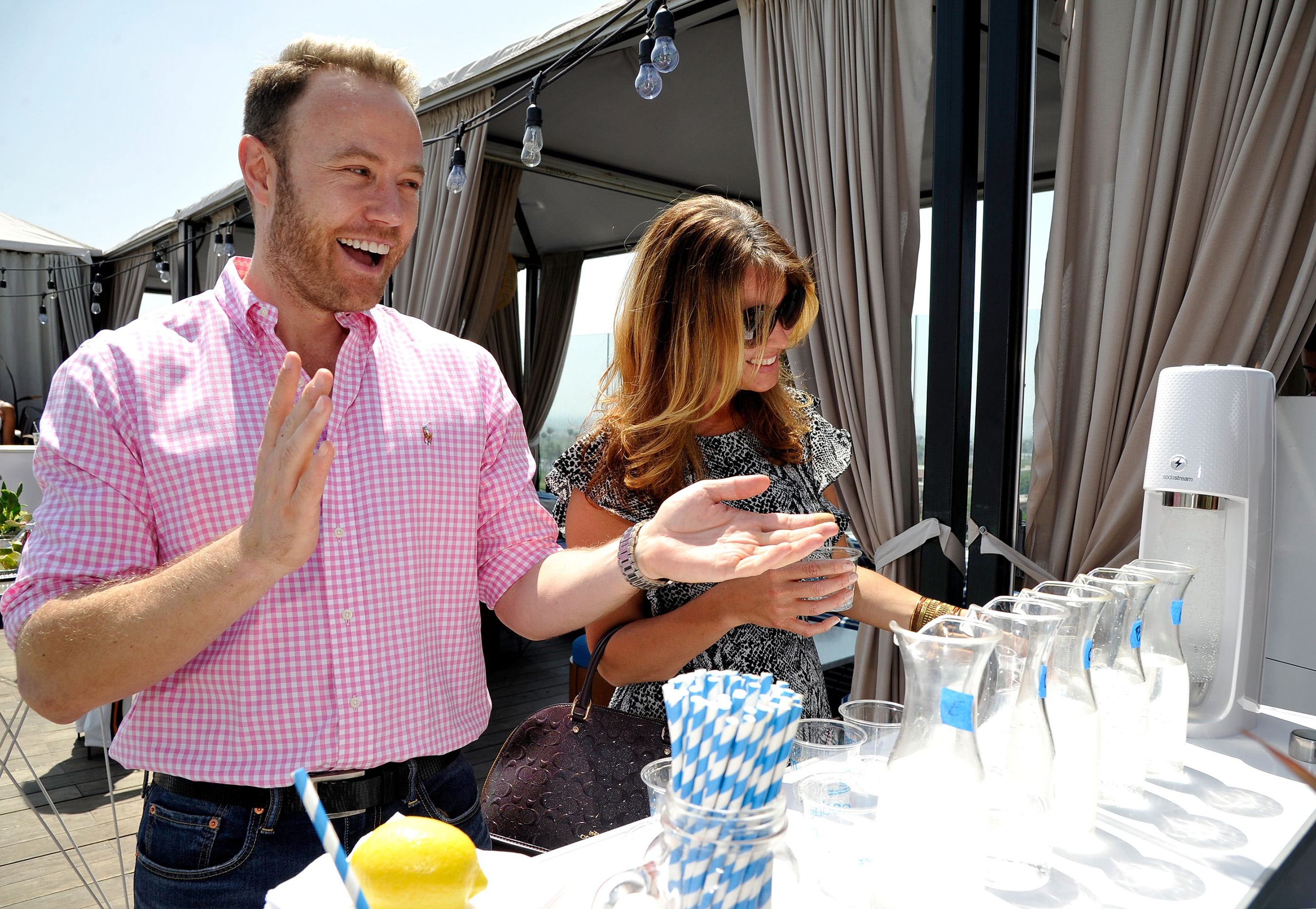 Paul Zahn and Silamith Maclean take a sparkling water blind taste test at SodaStream's National Hydration Day party on June 20, 2018.