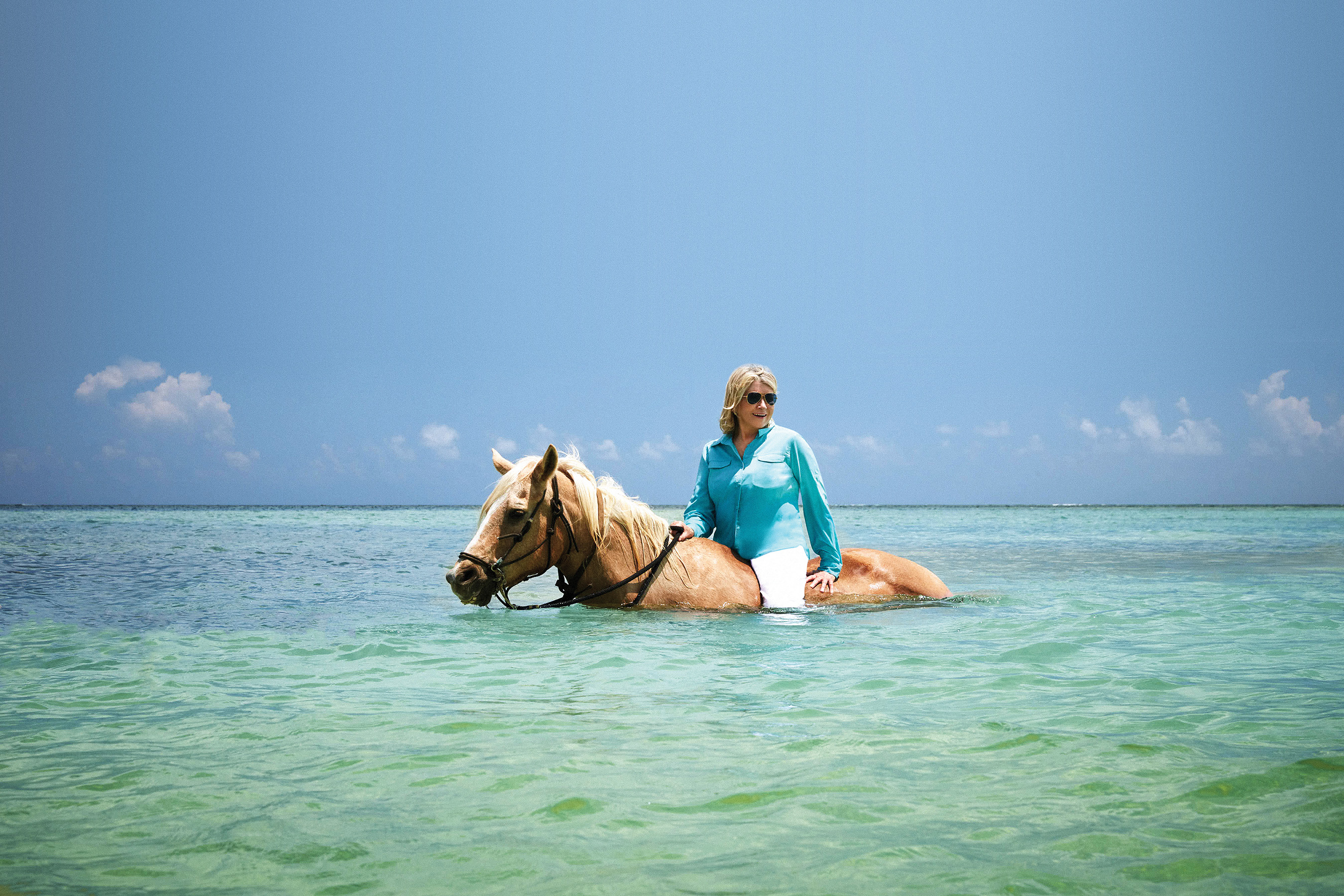 Martha Stewart & MSC Cruises curated shore excursion in Grand Cayman includes a refreshing horseback ride through the crystal blue Caribbean Sea. (Credit: Douglas Friedman)