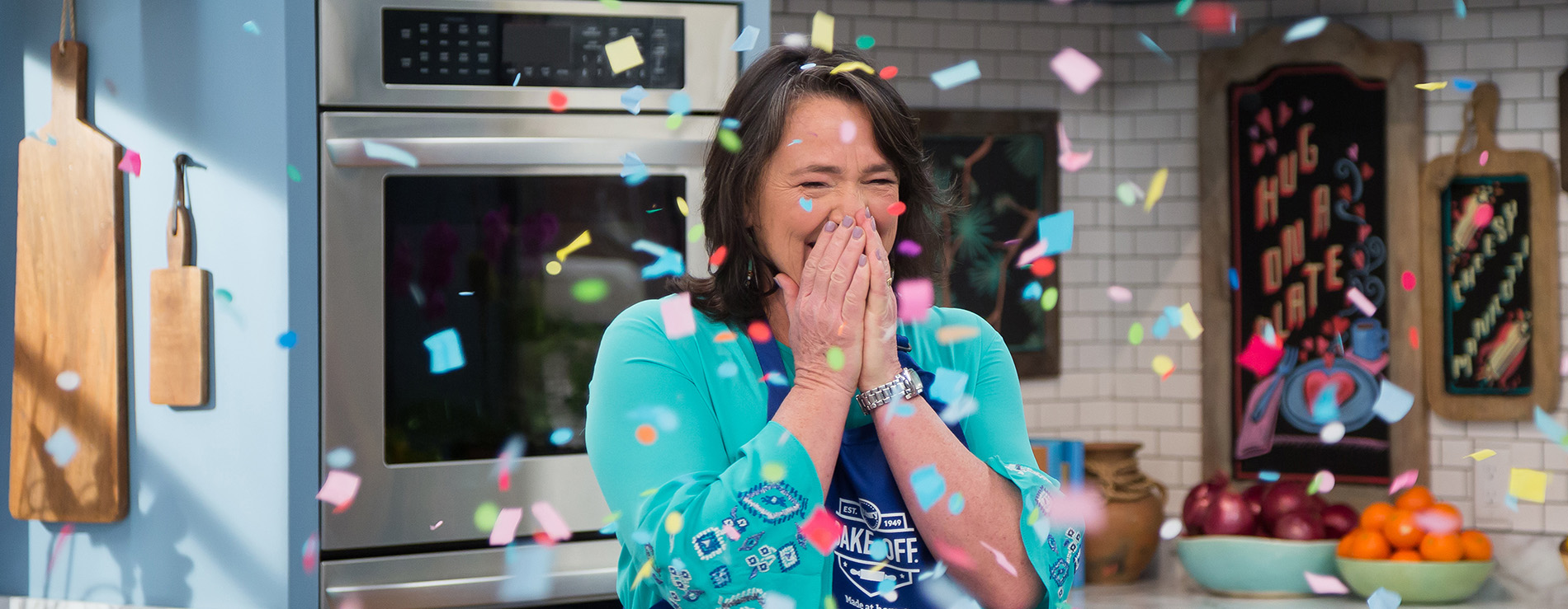 A very happy Amy Nelson is showered with confetti as she learns she won the contest.
