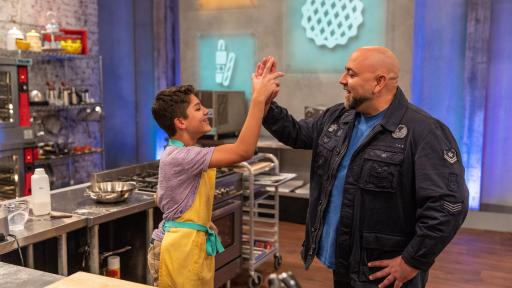 Enzo Consani and Duff Goldman high five