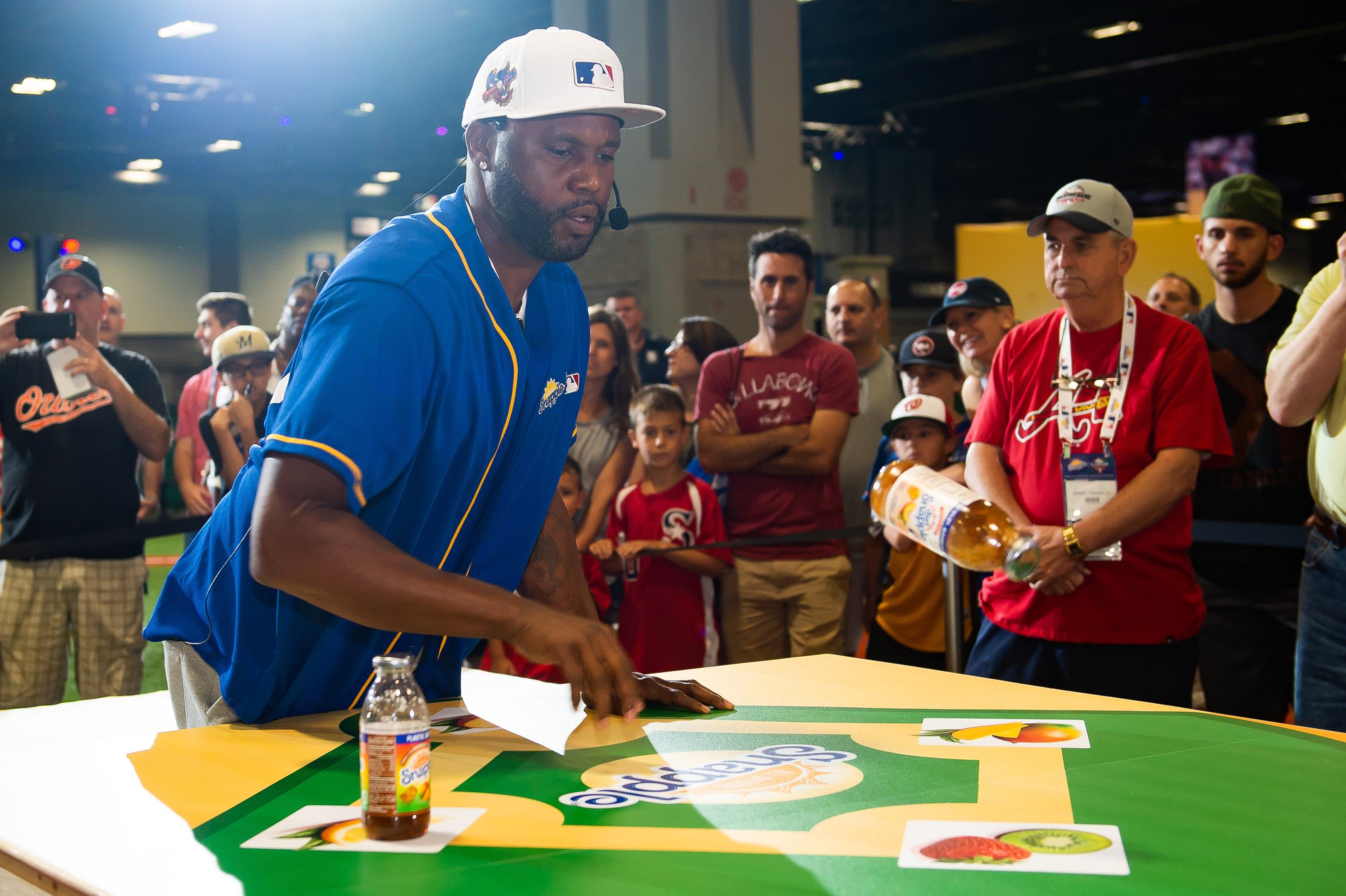 "Former MLB All-Stars Cal Ripken Jr. and Cliff Floyd battled for the title of ""Flip for Flavor"" champion at Snapple's first-ever All-Star Bottle Flip Challenge at FanFest where the players accurately flipped Snapple bottles onto fruit bases resembling a baseball diamond on Tuesday, July 17 in Washington."