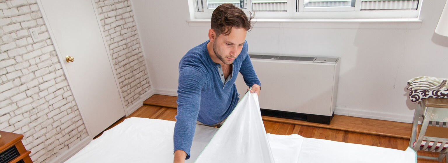 Man removing Peelaways sheets from mattress
