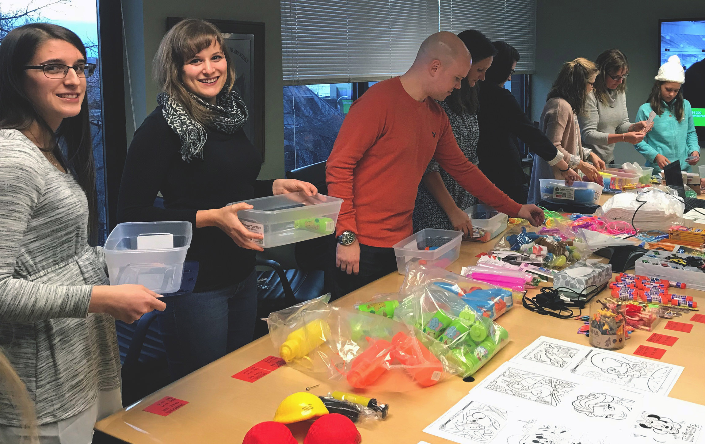 Volunteers from Crowe's Burlington, Vermont office assemble care packages for kids.