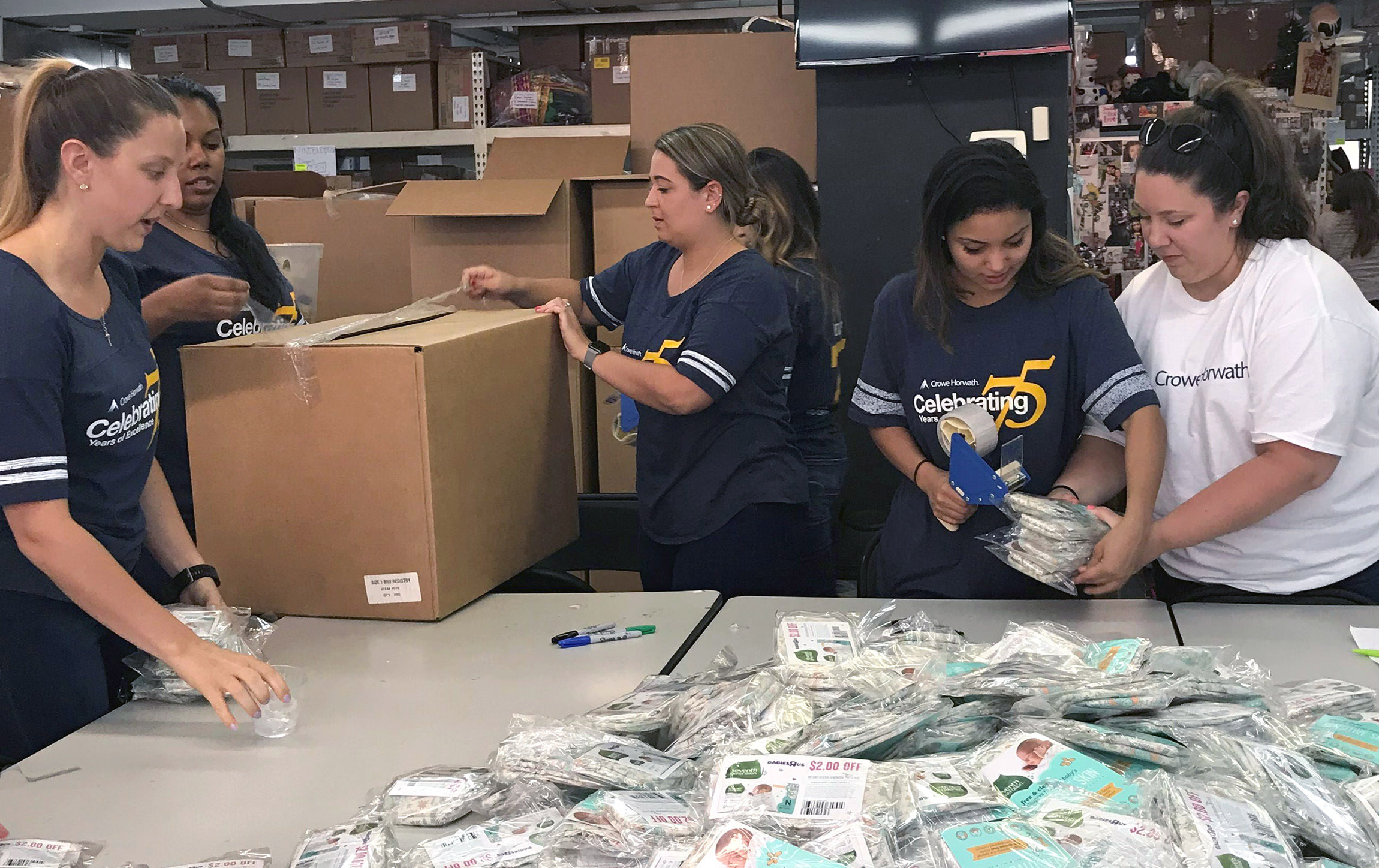 Crowe personnel from the New York and Livingston, New Jersey offices compile care packages.