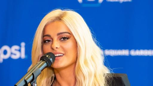 Close-up of Bebe Rexha singing in front of an audience