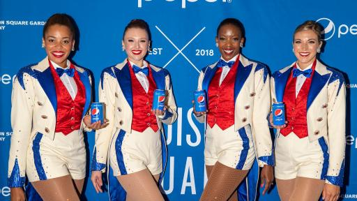 Radio City Rockettes (L to R: Sam Berger, Tiffany Billings, Danelle Morgan and Taylor Shimko) Posing for a picture.