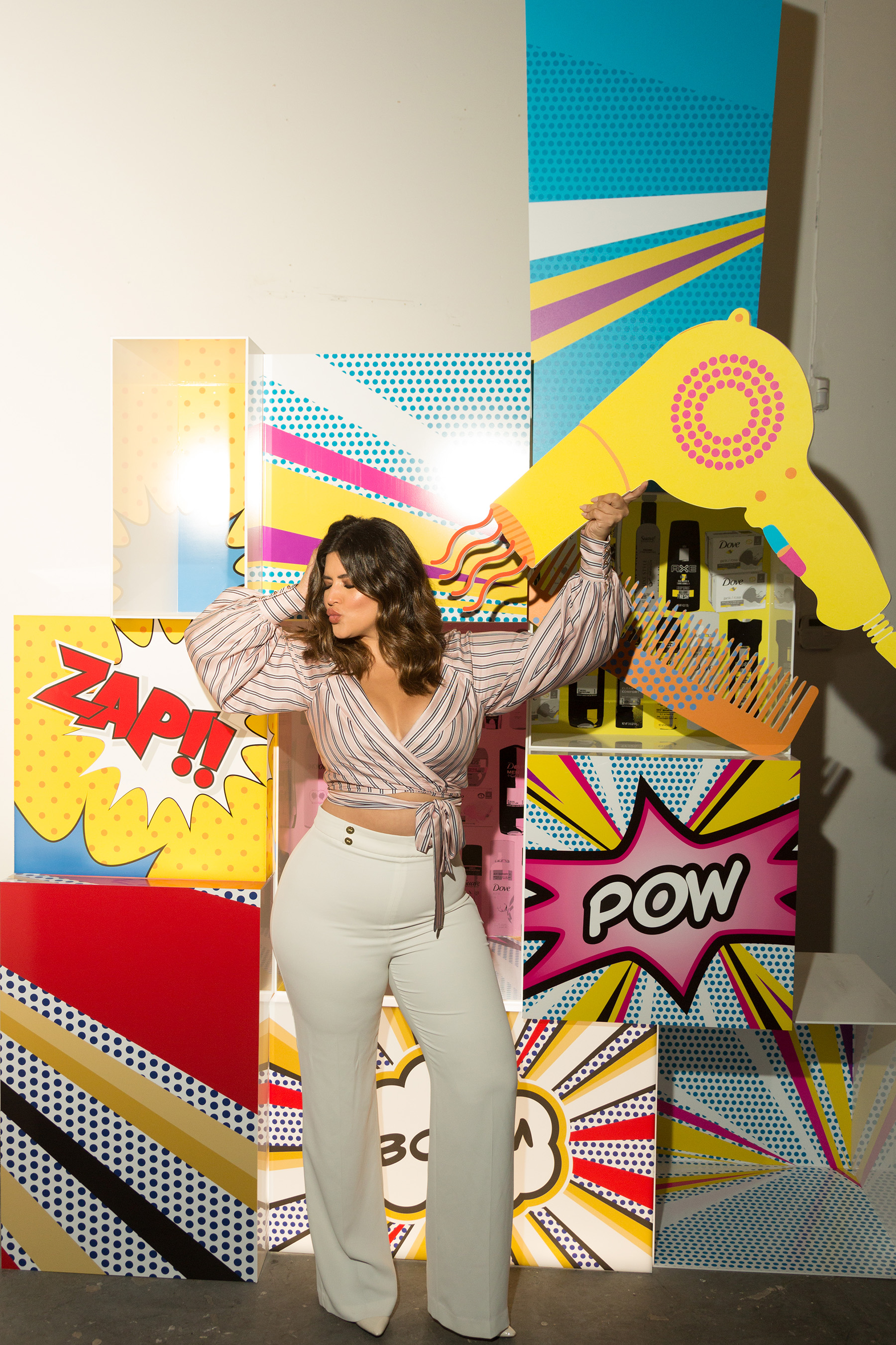 Denise Bidot having fun with the interactive Unilever Beauty and Personal Care customized art installation
