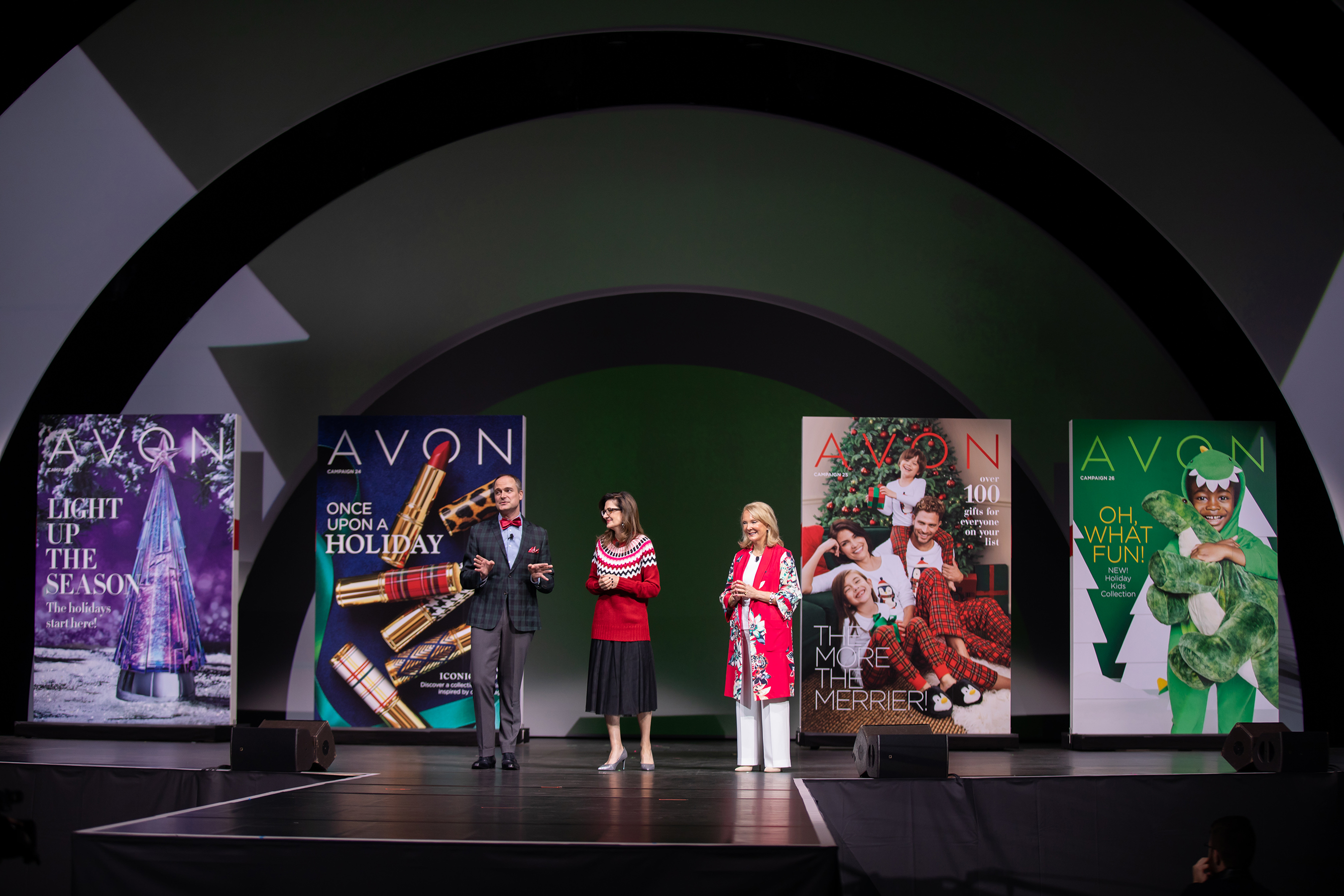 Avon Executives (From L to R- Michael Sengstack, Marketing Director, Fashion & Home, New Avon, LLC; Debi Theis, Vice President, Merchant, Marketing and Product Innovation, New Avon, LLC and Betty Palm, President, Social Selling for New Avon, LLC) preview Avon holiday collection to Avon Representatives at RepFest 2018.