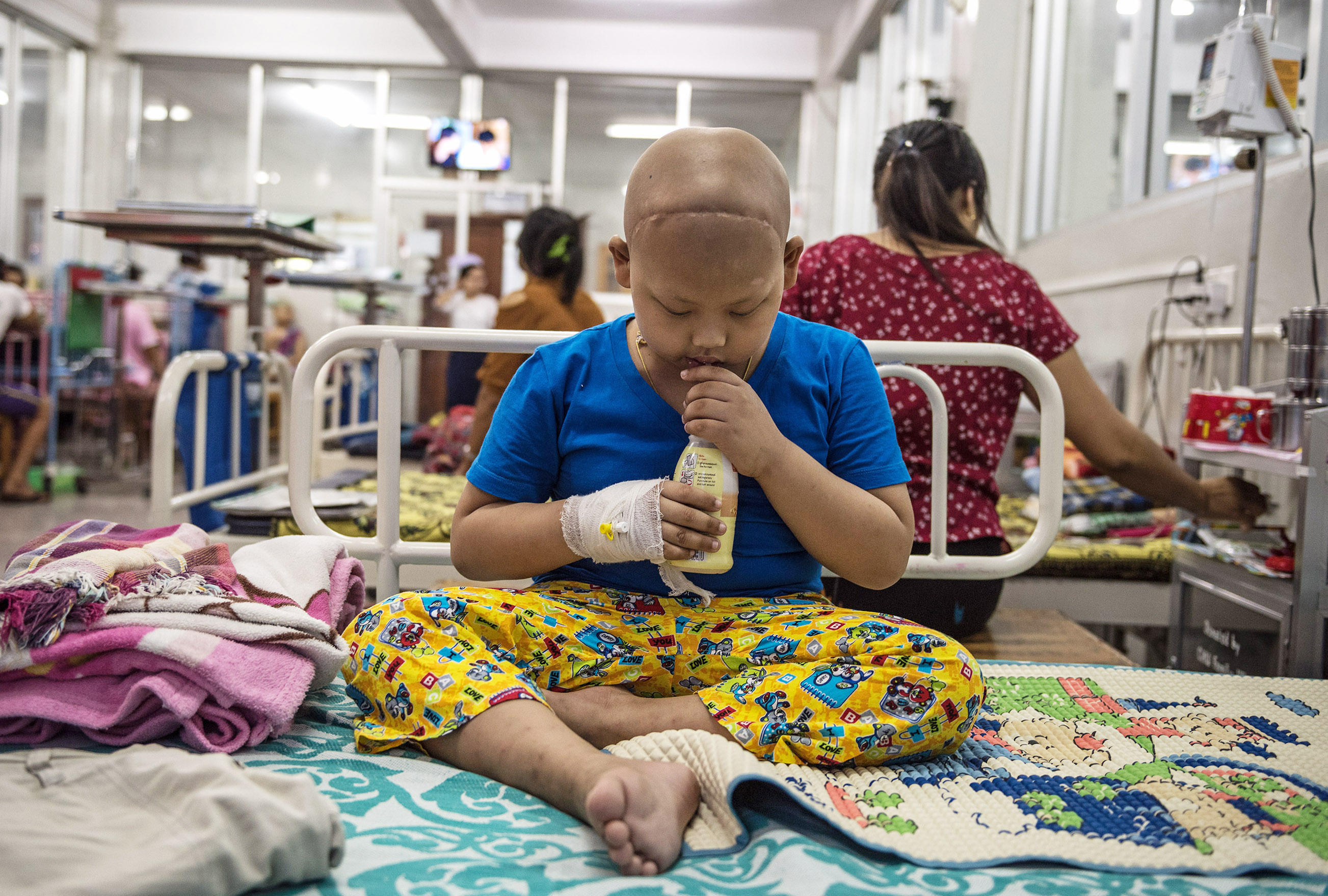 This patient was photographed in the Yangon Children's Hospital in Yangon, Myanmar, a collaborating site with the St. Jude Global network. Please credit Scott A. Woodward for use of this photo.