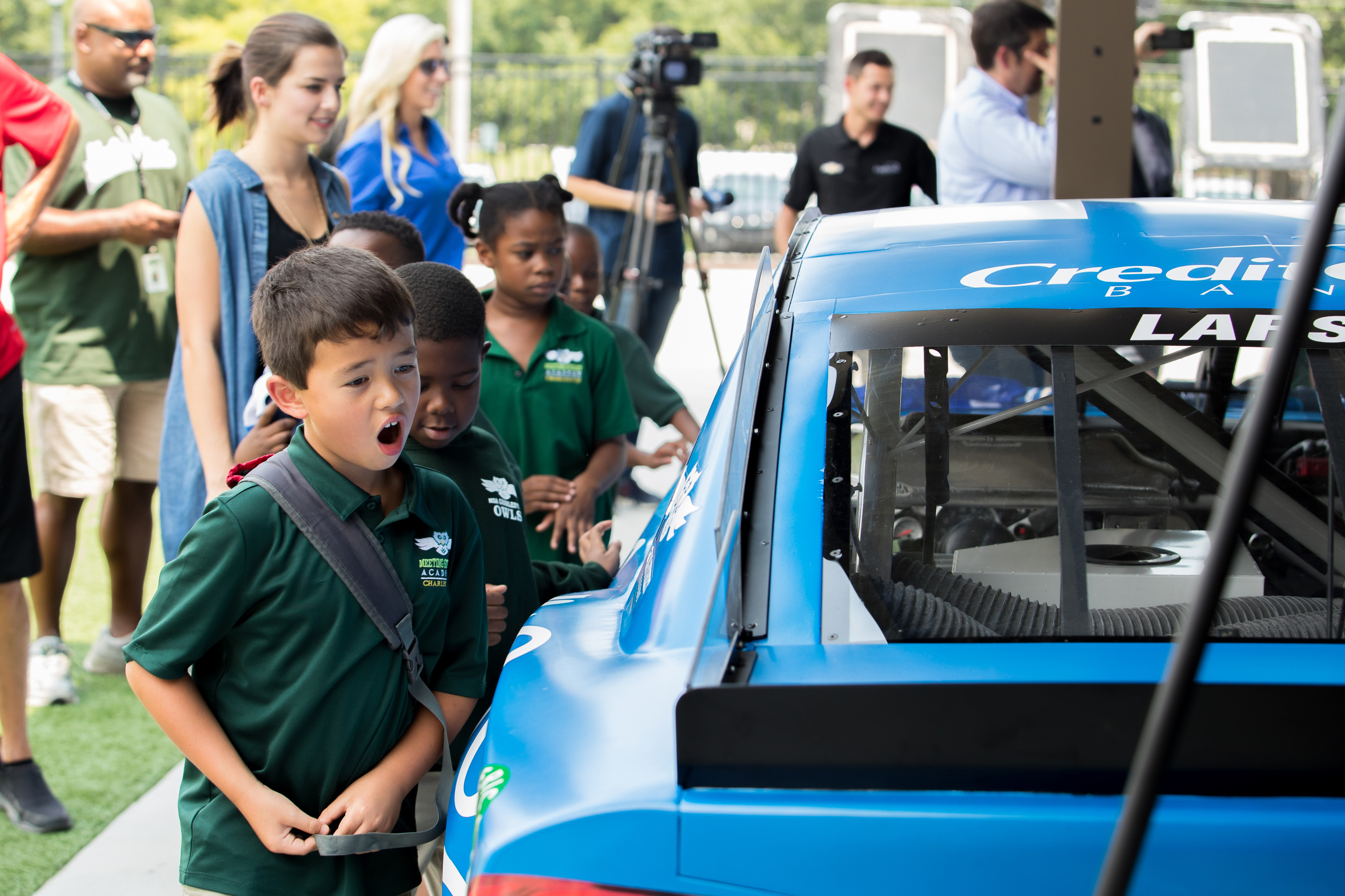 Credit One Bank and Kyle Larson visit with Meeting Street Academy students