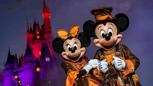 Mickey and Minnie Mouse dressed in Halloween garb.