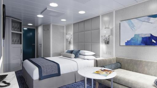 The Concierge Veranda Stateroom bedroom with cool colors and a bed in the center of the room.