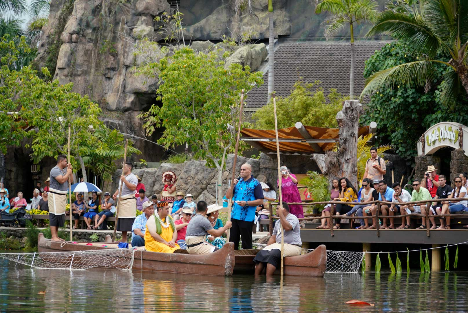 Polynesian Cultural Center President & CEO Alfred Grace welcomes crowd for the world premiere of Huki, as he is pulled into the freshwater lagoon on a canoe via fishing net.