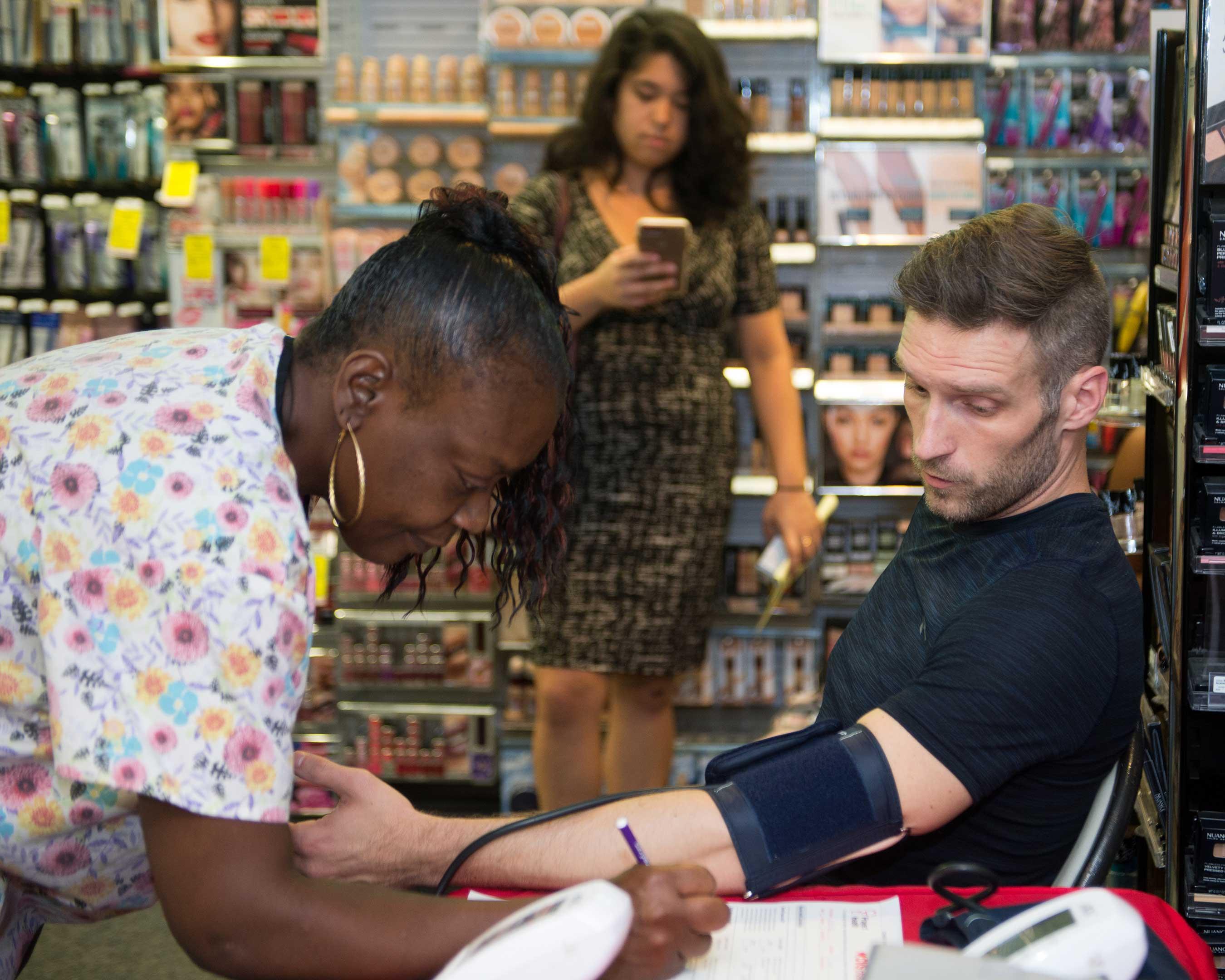 Man Gets BP Screening at Project Health